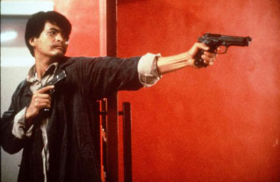 Chow Yun Fat has guns
