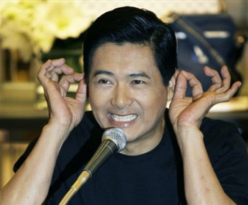Chow Yun Fat touches his ears